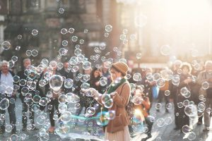be a champion of user experience - image of a woman blowing bubbles