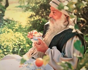 Osho drinking a cup of tea